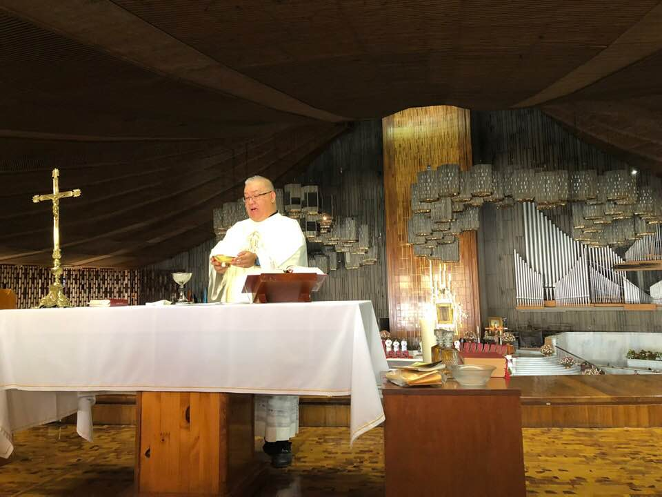 Father Dindo celebrates Mass