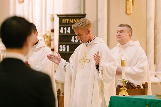 Father Mark Bernhard at Mass