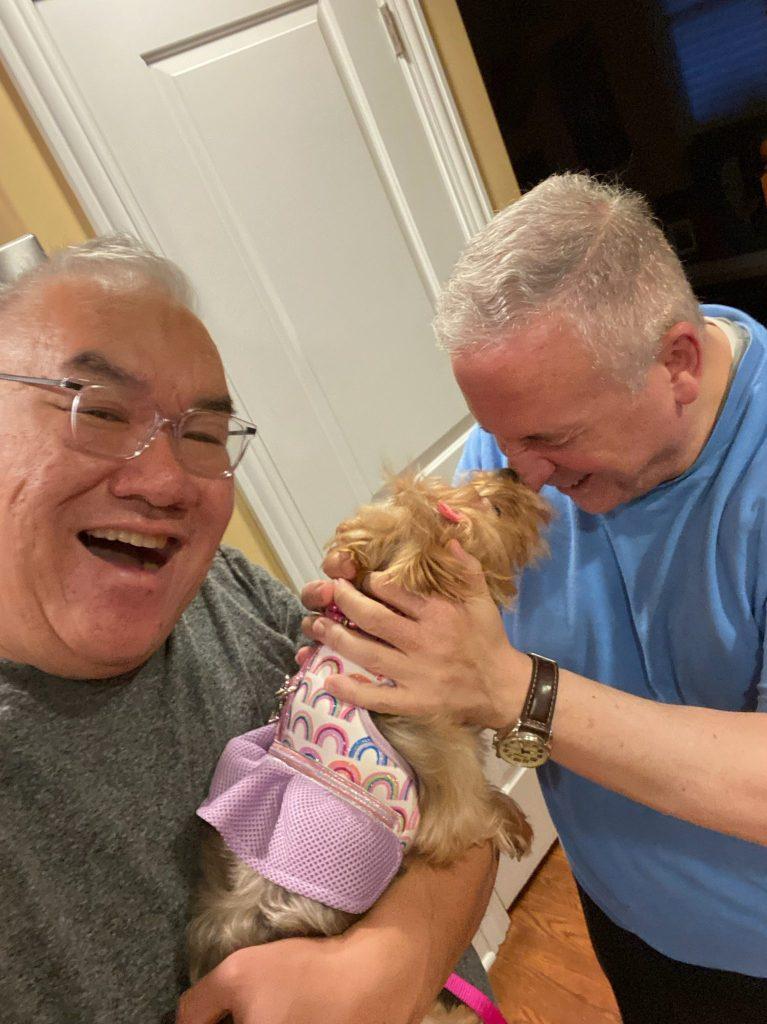 Fr. Sam with Fr. Dindo's dog.